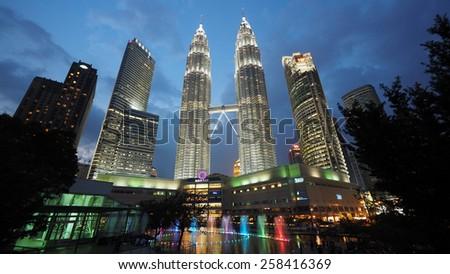 Kuala Lumpur, Malaysia - May 6, 2014: The iconic Petronas Twin Towers at night on May 6th, 2014, in Kuala Lumpur, Malaysia.  - stock photo