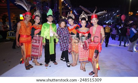 KUALA LUMPUR, MALAYSIA-MAY 25:Tourist and unidentified Malaysians dancer during the Festival Colours of 1 Malaysia May 25, 2013 in Kuala Lumpur Malaysia. 25.72million tourist visited Malaysia in 2013. - stock photo