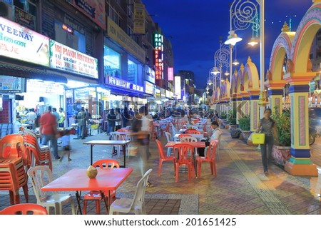 KUALA LUMPUR MALAYSIA - 30 May, 2014: Unidentified people shop and dine in Little India in Brickfields. Brickfields has large number of Indian business and population of Indian people.   - stock photo
