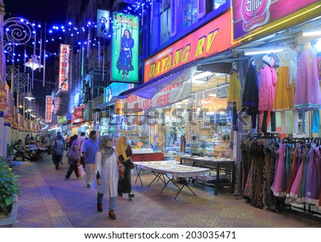 KUALA LUMPUR MALAYSIA - 30 May, 2014:Unidentified people shop and dine in Little India in Brickfields. Brickfields has large number of Indian business and population of Indian people.   - stock photo