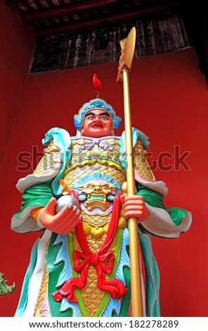 KUALA LUMPUR, MALAYSIA - MAY 18, 2012: Vintage statue of door god, Shen Shu with a battle axe at the Guan Di (God of War) Taoist temple in KL Chinatown. The temple is one of the oldest in Kuala Lumpur