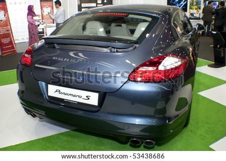 KUALA LUMPUR, MALAYSIA - MEI 19 : A Porsche Panamera S (Model Year 2010) is on display during the 6th World Islamic Economic Forum (WIEF) Mei 19, 2010 in Kuala Lumpur Malaysia. - stock photo