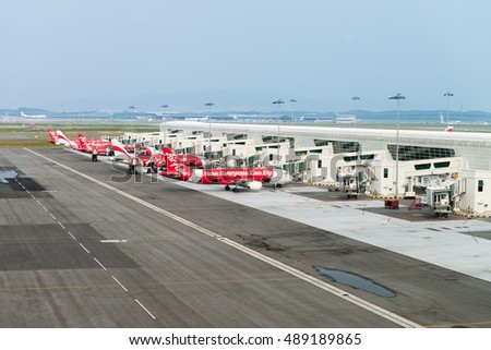KUALA LUMPUR, MALAYSIA - 02 NOV 2014: Airplanes in KLIA 2 airport. KLIA 2 is the low-cost carrier terminal at Malaysia's main international airport KLIA.