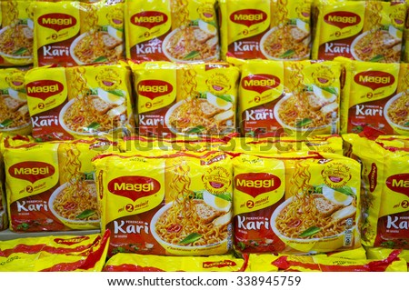 KUALA LUMPUR, MALAYSIA - NOV10TH 2015. Maggi instant noodles. Owned by Nestle, Maggi is an international brand of soups, stocks, bouillon cubes, ketchup, sauces, seasonings and instant noodles. - stock photo