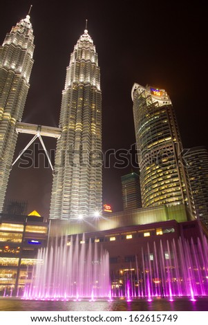 KUALA LUMPUR, MALAYSIA - NOVEMBER 8: Petronas Twin Towers exterior design on November 8, 2013 in Kuala Lumpur, Malaysia. These buildings are the most popular tourist attraction in Kuala Lumpur. - stock photo