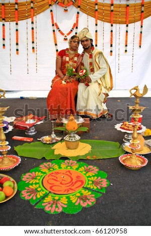 KUALA LUMPUR, MALAYSIA - NOVEMBER 28: The Indian couple wearing exotic traditional cloth at the Malaysia Wedding Exhibition on NOVEMBER 28, 2010 in KUALA LUMPUR, MALAYSIA