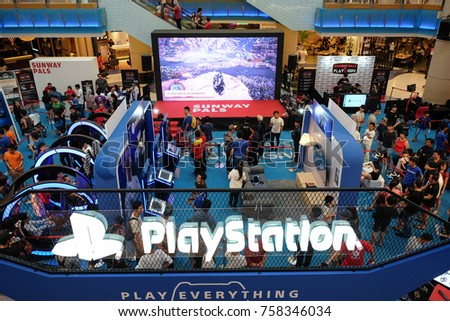 Kuala Lumpur, Malaysia -  3 November  2017 :  Video game lovers attending Sony PlayStation exhibition booth at Sunway Pyramid shopping mall on November 3.