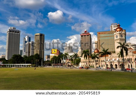 KUALA LUMPUR, MALAYSIA: OCT 8: Sultan Abdul Samad Building and city skyline on Oct 8, 2012 in Kuala Lumpur, Malaysia. Designed by A.C. Norman, and built in 1894-1897 during the British administration. - stock photo