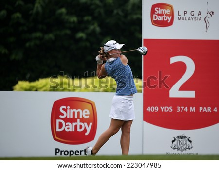 KUALA LUMPUR, MALAYSIA - OCTOBER 11, 2014: Austin Ernst of the USA tees off at the second hole of the KL Golf & Country Club during the 2014 Sime Darby LPGA Malaysia got tournament. - stock photo
