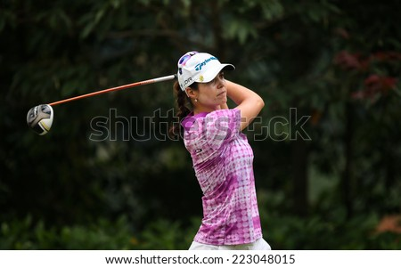 KUALA LUMPUR, MALAYSIA - OCTOBER 11, 2014: Beatriz Recari of Spain tees off at the fourth hole of the KL Golf & Country Club during the 2014 Sime Darby LPGA Malaysia golf tournament. - stock photo