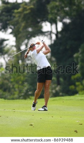 KUALA LUMPUR, MALAYSIA - OCTOBER 16: Brittany Lang of the USA drives the ball on the fairway on day 4 of the Sime Darby LPGA Malaysia 2011 golf tournament on Oct 16, 2011 in Kuala Lumpur, Malaysia. - stock photo