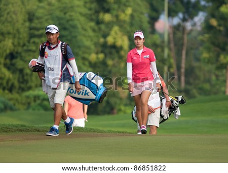 KUALA LUMPUR, MALAYSIA - OCTOBER 16: Chella Choi of South Korea walks towards the green at the Sime Darby LPGA Malaysia 2011 in Kuala Lumpur Golf & Country Club, Malaysia on October 16, 2011. - stock photo