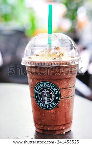 KUALA LUMPUR, MALAYSIA - October 31, 2010: Glass of fresh Starbucks Coffee Frappuccino Blended Beverages. Starbucks is the world's largest coffee house with over 20,000 stores in 61 countries.  - stock photo
