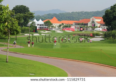 KUALA LUMPUR, MALAYSIA - OCTOBER 10: LPGA golfers play in front of a crowd at hole #18 facing the clubhouse at the Sime Darby LPGA 2012 golf tournament on Oct 10, 2012 in Kuala Lumpur, Malaysia. - stock photo
