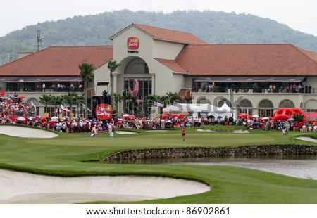KUALA LUMPUR, MALAYSIA - OCTOBER 16: LPGA golfers play in front of a crowd at hole #18 facing the clubhouse at the Sime Darby LPGA 2011 golf tournament on Oct 16, 2011 in Kuala Lumpur, Malaysia. - stock photo