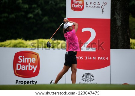 KUALA LUMPUR, MALAYSIA - OCTOBER 11, 2014: Marina Alex of the USA tees off at the second hole of the KL Golf & Country Club during the 2014 Sime Darby LPGA Malaysia golf tournament. - stock photo