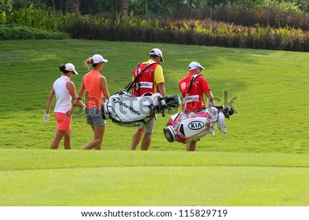KUALA LUMPUR, MALAYSIA - OCTOBER 10: Michelle Wie of the USA and Nicole Castrale USA during the Sime Darby LPGA 2012 golf tournament on Oct 10, 2012 in Kuala Lumpur, Malaysia. - stock photo