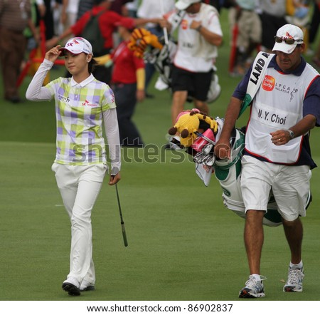 KUALA LUMPUR, MALAYSIA- OCTOBER 16: Na Yeon Choi of South Korea acknowledges the crowd's cheers at the final hole of the Sime Darby LPGA 2011 golf tournament on Oct 16, 2011 in Kuala Lumpur, Malaysia. - stock photo