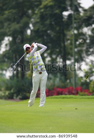 KUALA LUMPUR, MALAYSIA - OCTOBER 16: Na Yeon Choi of South Korea hits on the fairway on day 4 of the Sime Darby LPGA Malaysia 2011 golf tournament on Oct 16, 2011 in Kuala Lumpur, Malaysia. - stock photo