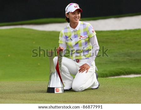 KUALA LUMPUR, MALAYSIA - OCTOBER 16: Na Yeon Choi of South Korea poses with her trophy after winning the Sime Darby LPGA Malaysia 2011 golf tournament on October 16, 2011 in Kuala Lumpur, Malaysia. - stock photo