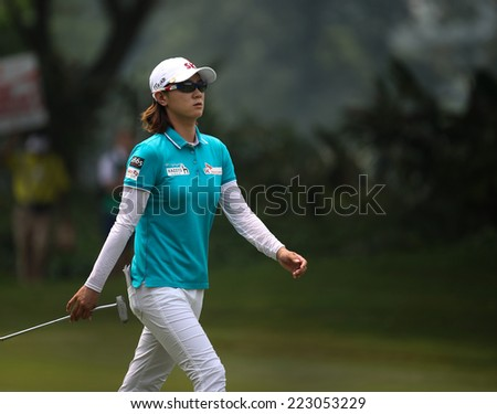 KUALA LUMPUR, MALAYSIA - OCTOBER 10, 2014: Na Yeon Choi of South Korea walks to the green of the ninth hole of the KL Golf & Country Club at the 2014 Sime Darby LPGA Malaysia golf tournament. - stock photo