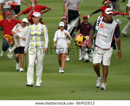 KUALA LUMPUR, MALAYSIA - OCTOBER 16: Na Yeon Choi of South Korea walks to the green of the final hole on day 4 of the Sime Darby LPGA 2011 golf tournament on Oct 16, 2011 in Kuala Lumpur, Malaysia. - stock photo