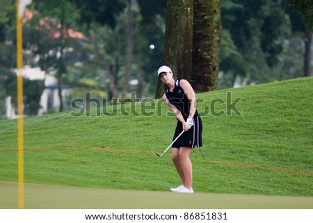 KUALA LUMPUR, MALAYSIA - OCTOBER 16:Paige McKenzie of the USA chips towards the hole at the Sime Darby LPGA Malaysia 2011 in Kuala Lumpur Golf & Country Club, Malaysia on October 16, 2011. - stock photo