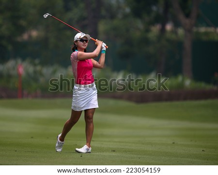 KUALA LUMPUR, MALAYSIA - OCTOBER 10, 2014: Park Hee Young of South Korea plays on the fairway of the ninth hole of the KL Golf & Country Club at the 2014 Sime Darby LPGA Malaysia golf tournament. - stock photo
