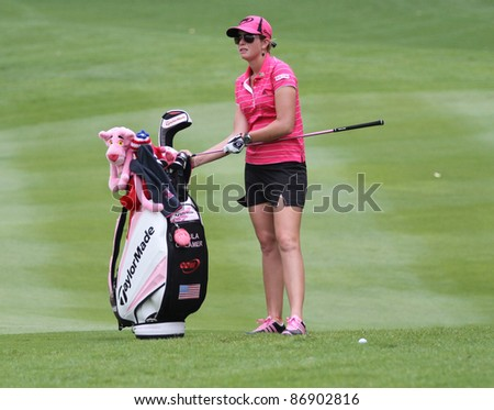 KUALA LUMPUR, MALAYSIA - OCTOBER 16: Paula Creamer of the USA prepares to play at the fairway of hole #18 during the Sime Darby LPGA 2011 golf tournament on Oct 16, 2011 in Kuala Lumpur, Malaysia. - stock photo