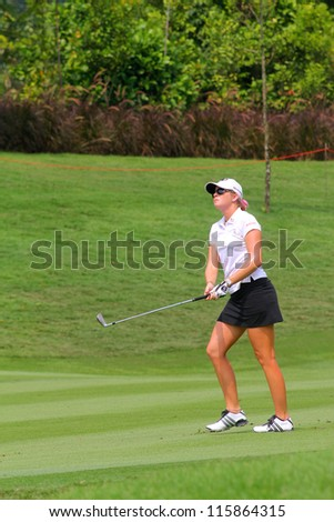 KUALA LUMPUR, MALAYSIA - OCTOBER 10: Paula Creamer of the USA watches her shot to hole #11 on day 2 of the Sime Darby LPGA Malaysia 2012 golf tournament on Oct 10, 2012 in Kuala Lumpur, Malaysia. - stock photo