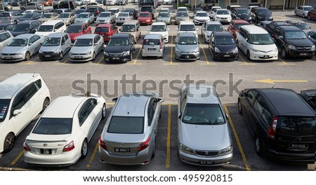 Kuala Lumpur, MALAYSIA - 09 OCTOBER  : Rows of the number of cars parked in a public parking lots in the holidays. Wilayah Persekutuan Kuala Lumpur, 2016 .