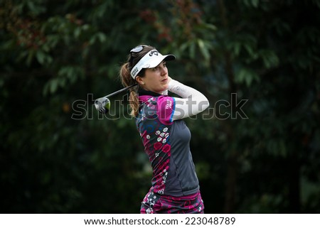 KUALA LUMPUR, MALAYSIA - OCTOBER 11, 2014: Sandra Gal of Germany tees off at the fourth hole of the KL Golf & Country Club during the 2014 Sime Darby LPGA Malaysia golf tournament. - stock photo