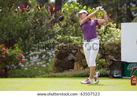 KUALA LUMPUR, MALAYSIA - OCTOBER 22: Scottish Catriona Matthew finishes teeing off on hole 2 on Day 1 of the Sime Darby LPGA Golf Tournament on October 22, 2010 in Kuala Lumpur, Malaysia