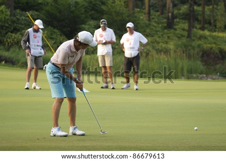 KUALA LUMPUR, MALAYSIA - OCTOBER 15: Scottish Catriona Matthew putts out on Day 3 of Sime Darby LPGA Golf October 15, 2011 in Kuala Lumpur, Malaysia.