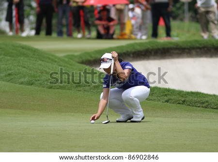 KUALA LUMPUR, MALAYSIA - OCTOBER 16: Se Ri Pak of South Korea prepares to putt at the green of hole #18 during the Sime Darby LPGA 2011 golf tournament on Oct 16, 2011 in Kuala Lumpur, Malaysia. - stock photo