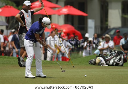 KUALA LUMPUR, MALAYSIA - OCTOBER 16: Se Ri Pak of South Korea putts at the green of hole #18 during the Sime Darby LPGA 2011 golf tournament on Oct 16, 2011 in Kuala Lumpur, Malaysia. - stock photo