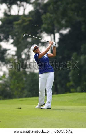 KUALA LUMPUR, MALAYSIA - OCTOBER 16: Se Ri Pak of South Korea watches her shot to hole #9 on day 4 of the Sime Darby LPGA Malaysia 2011 golf tournament on Oct 16, 2011 in Kuala Lumpur, Malaysia. - stock photo