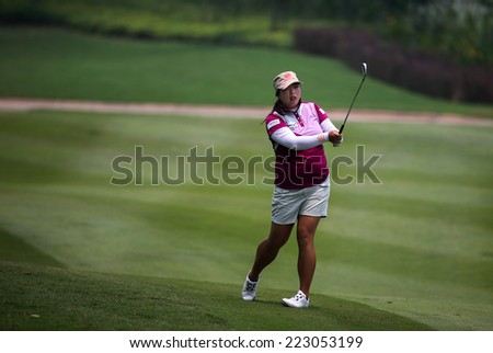 KUALA LUMPUR, MALAYSIA - OCTOBER 10, 2014: Shanshan Feng of China plays on the fairway of the ninth hole of the KL Golf & Country Club at the 2014 Sime Darby LPGA Malaysia golf tournament. - stock photo
