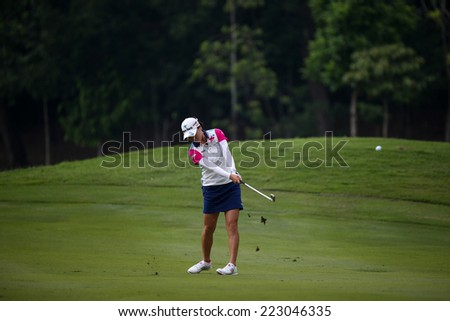 KUALA LUMPUR, MALAYSIA - OCTOBER 11, 2014: So Yeon Ryu of South Korea  makes a shot from the fairway of the ninth hole of the KLGC Club during the 2014 Sime Darby LPGA Malaysia golf tournament. - stock photo