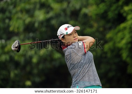 KUALA LUMPUR, MALAYSIA - OCTOBER 10, 2015: South Korea's Ha Na Jang tees off at the sixth hole of the KL Golf & Country Club on Round 3 day at the 2015 Sime Darby LPGA Malaysia golf tournament.  - stock photo