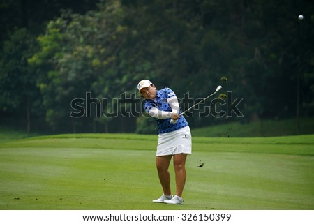 KUALA LUMPUR, MALAYSIA - OCTOBER 10, 2015: South Korea's Inbee Park plays on the fairway of the ninth hole of the KL Golf & Country Club during the 2015 Sime Darby LPGA Malaysia golf tournament.  - stock photo