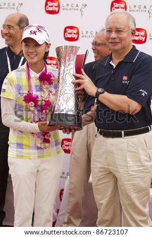 KUALA LUMPUR, MALAYSIA - OCTOBER 16: South Korean Na Yeon Choi receives champions trophy from Prime Minister Najib after winning the Sime Darby LPGA Golf October 16, 2011 in Kuala Lumpur, Malaysia.