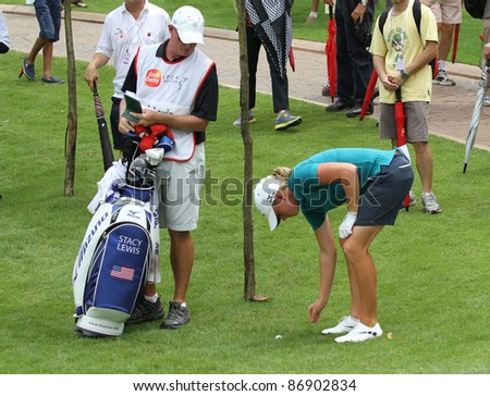 KUALA LUMPUR, MALAYSIA - OCTOBER 16: Stacy Lewis prepares get out of the rough after a mishit at hole #18 during the Sime Darby LPGA 2011 golf tournament on Oct 16, 2011 in Kuala Lumpur, Malaysia. - stock photo