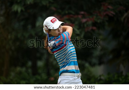 KUALA LUMPUR, MALAYSIA - OCTOBER 11, 2014: Sun Young Yoo of South Korea tees off at the fourth hole of the KL Golf & Country Club during the 2014 Sime Darby LPGA Malaysia golf tournament. - stock photo