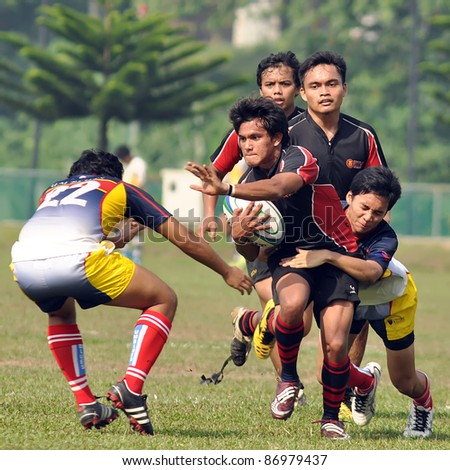 KUALA LUMPUR, MALAYSIA - OCTOBER 15:  Unidentified participants in action during a 10s Rugby Tournament Vice-Chancellor Cup at National Defense University Of Malaysia, Kuala Lumpur, Malaysia on October 15, 2011. - stock photo