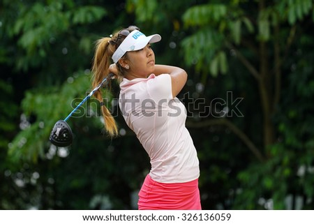 KUALA LUMPUR, MALAYSIA - OCTOBER 10, 2015: USA's Alison Lee tees off at the sixth hole of the KL Golf & Country Club on Round 3 day at the 2015 Sime Darby LPGA Malaysia golf tournament. - stock photo