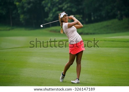 KUALA LUMPUR, MALAYSIA - OCTOBER 10, 2015:USA's Alison Lee tees off at the sixth hole of the KL Golf & Country Club on Round 3 day at the 2015 Sime Darby LPGA Malaysia golf tournament.  - stock photo
