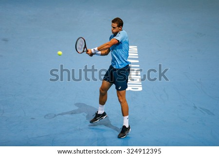KUALA LUMPUR, MALAYSIA - OCTOBER 01, 2015: Vasek Pospisil of Canada plays a backhand return during his match at the Malaysian Open 2015 Tennis tournament held at the Putra Stadium, Malaysia. - stock photo