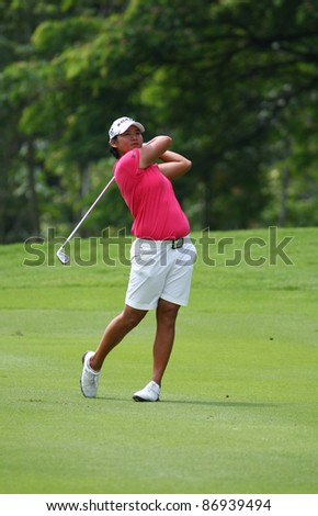 KUALA LUMPUR, MALAYSIA - OCTOBER 16: Yani Tseng of Chinese Taipei hits on the fairway on day 4 of the Sime Darby LPGA Malaysia 2011 golf tournament on Oct 16, 2011 in Kuala Lumpur, Malaysia. - stock photo