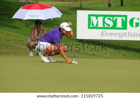 KUALA LUMPUR, MALAYSIA - OCTOBER 10: Yani Tseng of Chinese Taipei prepares to putt at the green of hole #6 at the Sime Darby LPGA 2012 golf tournament on Oct 10, 2012 in Kuala Lumpur, Malaysia. - stock photo